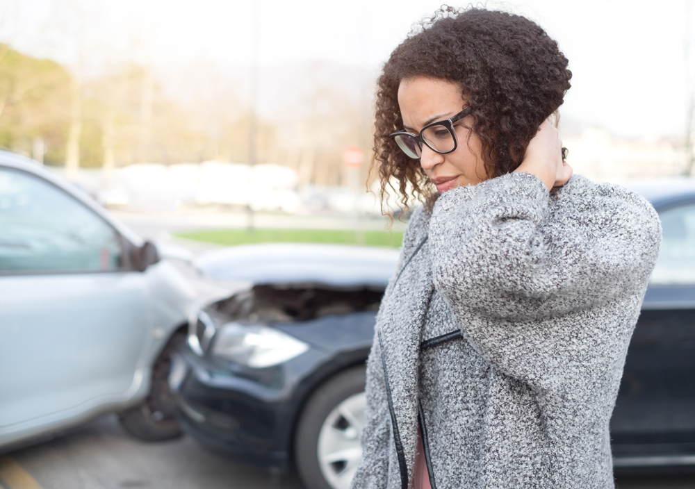 Woman suffering from a whiplash injury after an auto accident